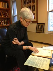 Professor Roberta Ervine peruses the archives of Ms. Srpouhie Essefian in the Zohrab Center.